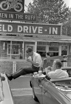 """Spring 1960. """"Efforts of John F. Kennedy's campaign team, including members of his family, in West Virginia during Kennedy's quest for the 1960 Democratic presidential nomination. Includes brother Bobby at a drive-in in Bluefield."""" From photos by Bob Lerner for the Look magazine article """"The Kennedys: A Family Political Machine."""""""