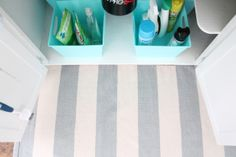 tips for organizing that dreaded area under your kitchen sink - and keeping it manageable with dollar store bins