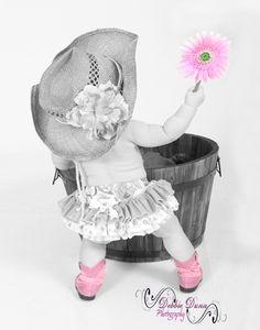 Love the pink in this photo - what an adorable little cowgirl! #littlecowgirl #cowboyhat #cowboyboots #cute