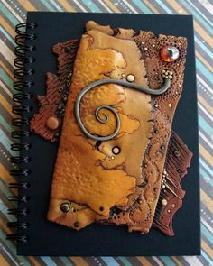 This is one of my favorite journal covers. Made of polymer clay. Doesn't it look like caramel? Mmmmm!