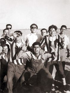 Group of football players in Spain celebrating victory after a game. Archivo de la Imagen de Castilla La Mancha (Public Domain) http://www.europeana.eu/portal/record/09407a/15AC7BB7C6B0D8B3B00002A4AE85F908F8C269C0.html