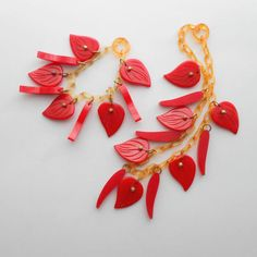 C. 1930s Bakelite and celluloid bracelet and necklace set featuring apple juiced hued chain and red leaf charms. #vintage #1930s #art_deco #jewelry #necklaces