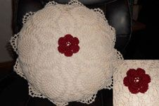 """Pineapple Lace Round Pillow.  Lindy writes: """"Marci had chosen these colors to match her bedroom. she has other pillows in Burgundy, but none are crocheted, so she was very excited to have it."""" pineappl lace, crochet pillow, round pillow"""