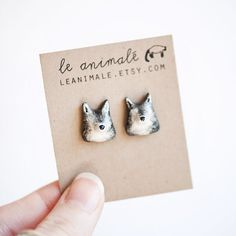 wolf earrings from leanimale on etsy. Amazing, and only $30!!
