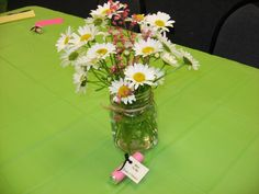 We used these for a bridal shower they set on each table....the wedding is pretty country so we just used some canning jars and some daisys that i cut out of my moms yard