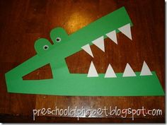 "Letter ""A"" Activity - Make an Alligator from the Letter A -  Repeat ""Alligator, Alligator"" in front of: (turn around - touch the ground) - (chomp your jaws - show your claws) - (get down low - move real slow) - (reach up high - wave goodbye)"