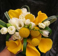 Kelly Barker loves this bouquet only using yellow tulips in place of callas 8/16/13