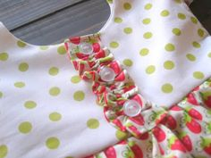 gather a tube of fabric, stitch to bodice, add buttons