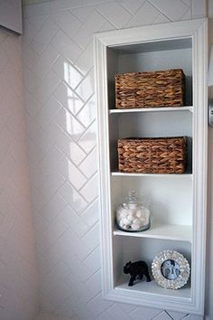 Perfect built in storage for small bathrooms, and a classy way to store that spare tp in those cute baskets