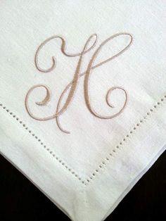 Taupe thread on ivory linen napkin.