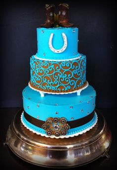 Teal and brown western wedding cake by Iris Candelaria.
