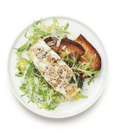 Poached Bass Over Frisée recipe: Gently cook the fish in a liquid flavored with shallot, thyme, parsley, and mustard seeds.
