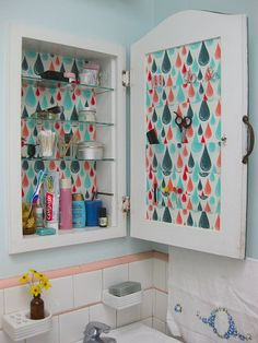 RP: Makeover your dull medicine cabinet with some pretty paper. fun!