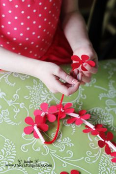 luau activity: making your own leis using straws and cardstock flowers