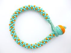 It's Free Pattern Friday! Visit the Craftsy blog to get the FREE jewelry pattern for this pretty button loop bracelet.