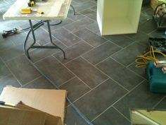 Staggered floor tile