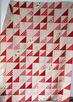 red half-square triangle quilt