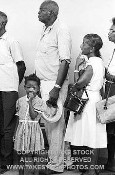 image 2290808. MATT HERRON/TAKE STOCK. Black Canton residents waiting in line to take voter registration oath before federal registrar. Canton, Mississippi,1965