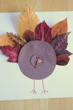 I like the idea of sending the kids on a scavenger hunt for different kinds of colorful fall leaves to complete this cute leaf feather turkey