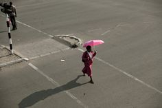 A woman crosses a Bulawayo street.