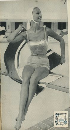 The overall-like buttons on the bodice of this chic 1950s swimsuit are so darling. #vintage #1950s #swimsuit #bathing_suit #beach #summer #fashion
