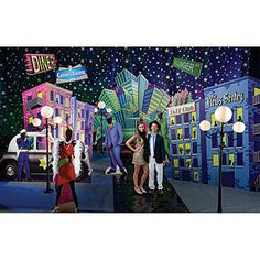 This Gangster Gala Theme Kit will transform your event into the jazzin' venue you've always wanted! Recreate the look of the Roaring Twenties with this colorful Gangster Gala Theme Kit.  The Gangster Gala Theme Kit includes: 1 Roaring 20's City Building, 1 Gangster Jazz Building, 1 Gangster Hotel Building, 1 Flapper Standee, 1 Gangster Standee, 1 Gangster Car Standee, 1 Police Car Standee, 1 Old World Lampost