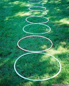 Hoop Alley Lay out eight plastic hoops in a straight line. Kids step into each hoop, lift it overhead, and drop it behind as they move forward. (Reset the row before the next person's turn.