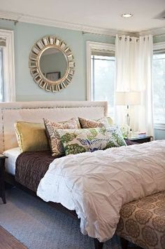 Light, bright and airy feel for a bedroom. Light blue/ aqua shade on the walls, bright white grommet curtains that add interest to the room bc they turn the corner. Chocolate brown, green yellow, blue accents, I would possibly add light orange or coral. I already have the tufted white comforter.