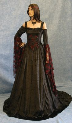 Renaissance dress idea. Change the color from black and red to olive green. Make it a full sleeve/cover the shoulder.