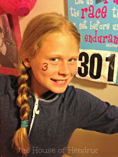 Kids love seeing their Birthday # on things. Cute idea to have siblings write the number on their faces.