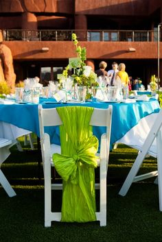 Teal and Lime Green Tables - thats my colors, with a little bright pink here and there. Not sure I like that exact set-up... but its an idea!