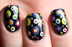 Argus Panoptes manicure: multi-dotted eyes over black
