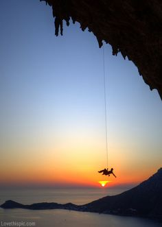 Hanging off the sun over the ocean... dream rock climbing location