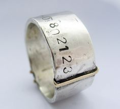 silver and gold heavy ring with gps co-ordinates