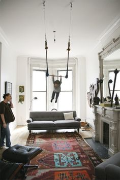 A trapeze in the living room.