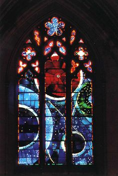Washington National Cathedral ~ The Space Window (stained glass by artist Rodney Winfield). The large red orb contains a piece of the moon rock presented to the Cathedral by the astronauts of Apollo XI.