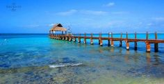 Take a peaceful stroll over the water at #SecretsAuraCozumel! #travel #ocean #paradise