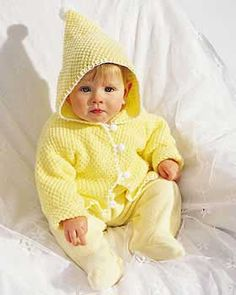 Ever-so-darling knit hoodie finished off with a sassy pom-pom on the pointed hood and button closure. Sizes 6 - 18 months (chest measurement 16-20 in [40.5-51cm). Shown in Bernat Softee Baby knit using size 4 mm (U.S. 6) needles.