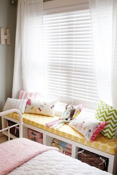 love this idea… ikea bookshelf turned on its side to be used as a daybed/window seat in a kids room.