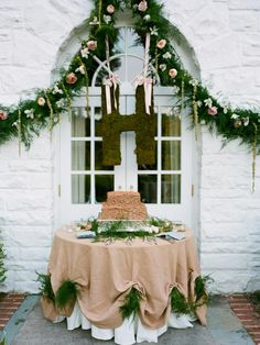 Grooms cake table with textured cake, moss hanging letter, and garland draped with flowers #MarieeAmi #Weddings