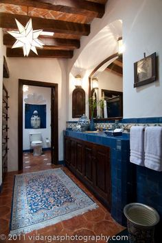 spanish style bathroom and the downstairs Mexican tile flooring :)