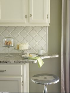 I really like this arabesque backsplash tile.  I would have a countertop with more black.