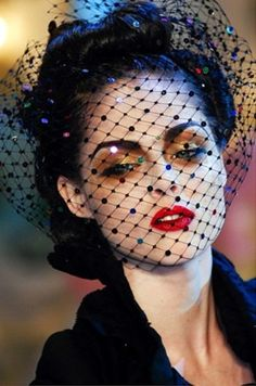 black sequin netted face veil, with gold eyeshadow & red lips .