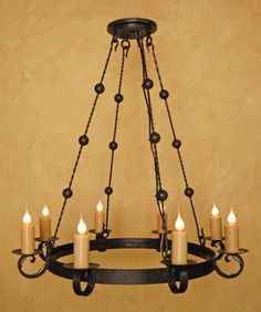 A unique Mediterranean style chandelier by Laura Lee Designs wrought iron lighting in Southern California
