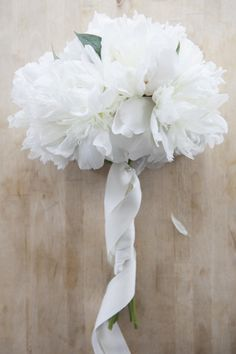 White DIY Peony Bouquet  Source:: Rustic Wedding Chic - rusticweddingchic.com/make-simple-peony-wedding-bouquet  View entire slideshow: Peony Bouquets on http://www.stylemepretty.com/collection/572/