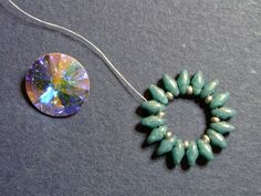 Easy way to bezel a Rivoli with SuperDuos. Netting secures the crystal back. #Seed #Bead #Tutorials