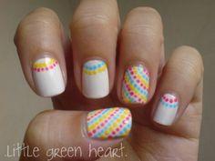 i kind of like the diagonal polka dots nail via Om K on e*rything nails