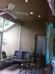 Our lanai and the container garden being tended by the boys...this is off of the playroom...