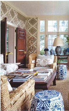 tory burch home- love those sisal chairs love the blue and white garden stools