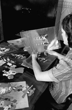 Animator with Mickey Mouse cells, 1938